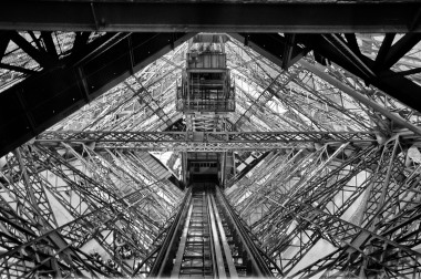 I think this is looking up from inside one of the legs of the Eiffel Tower but I am really not sure.